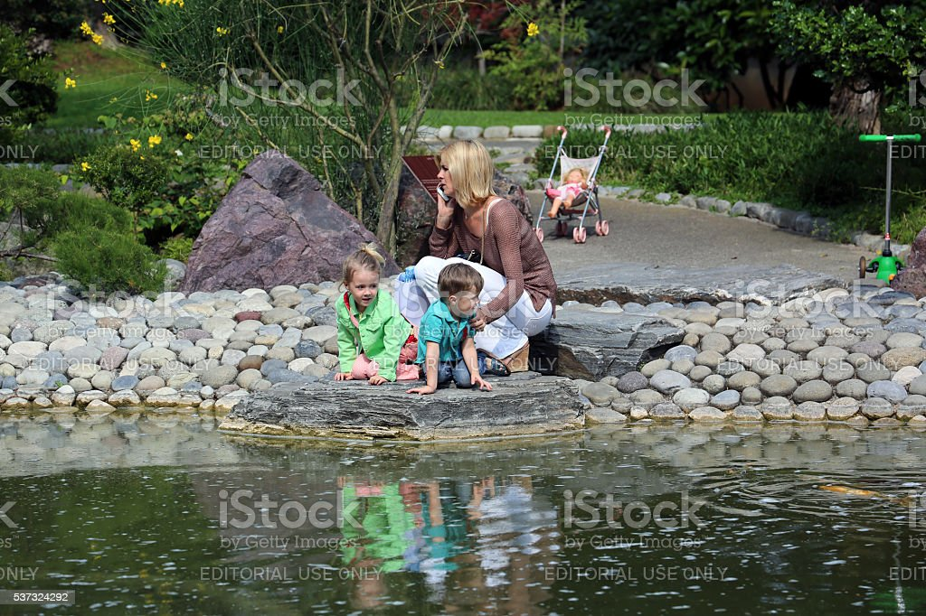 Young Children Playing at the Water's Edge stock photo