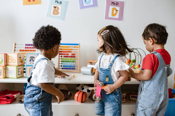 Young children playing with educational toys stock photo
