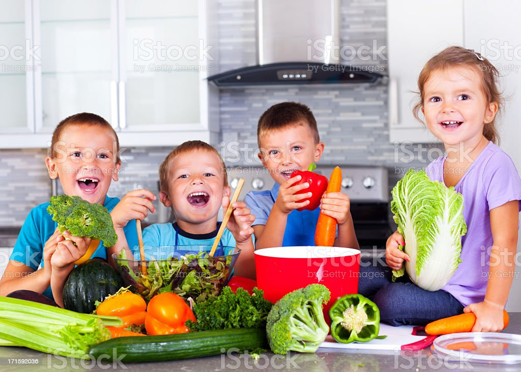 Young children preparing a healthy meal stock photo