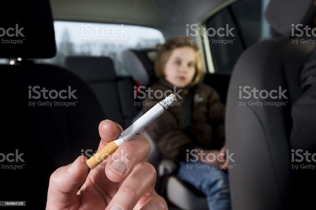 Young Children Suffering The Effects of In Car Passive Smoking stock photo