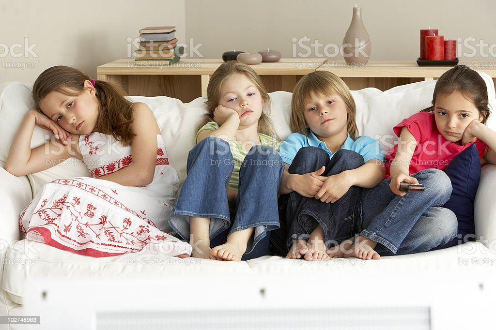 Young Children Watching Television at Home stock photo