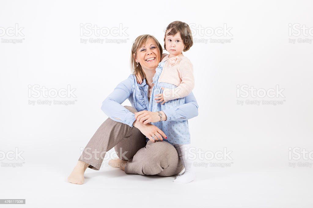 Young children with her mother in a studio stock photo
