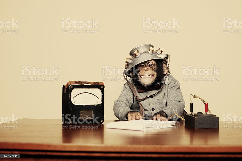 Young Chimpanzee Nerd with Mind Reading Helmet stock photo