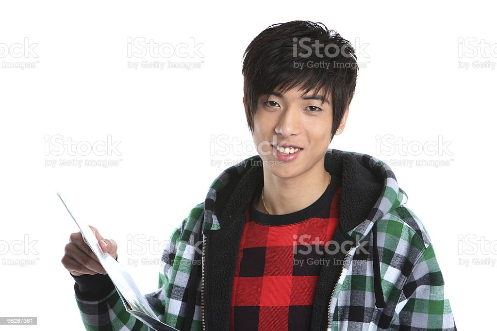 Young Chinese boy with books royalty-free stock photo