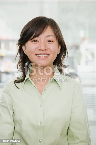 519052198 istock photo Young Chinese businesswoman smiling at camera 1035194484