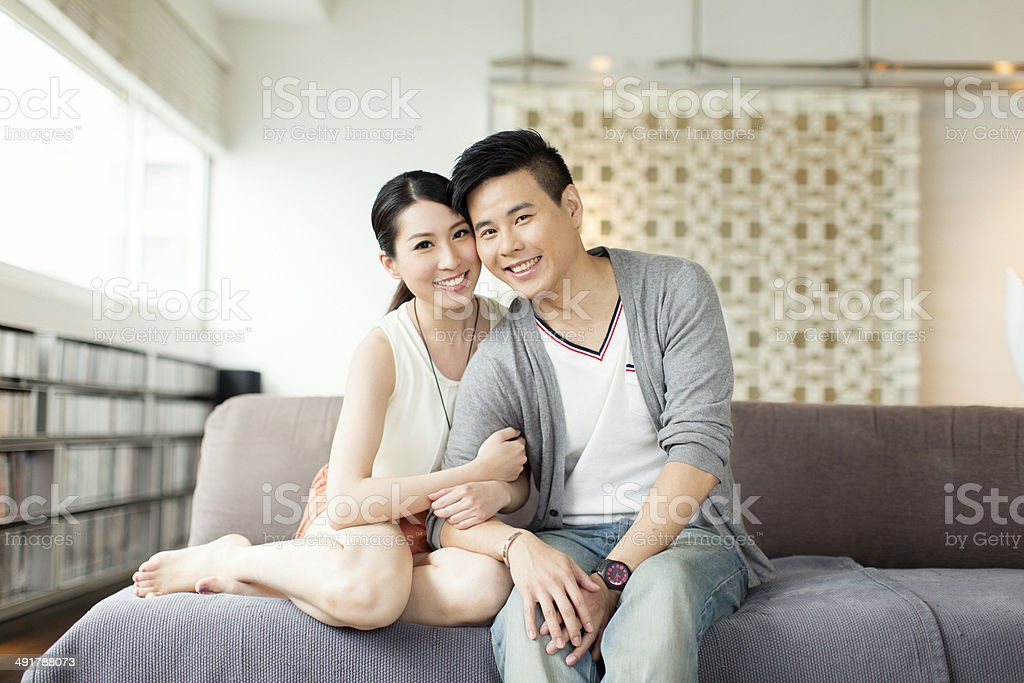 Young Chinese Couple Portrait on Couch stock photo