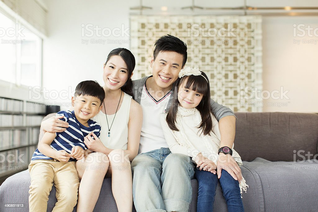 Young Chinese Family in Apartment stock photo
