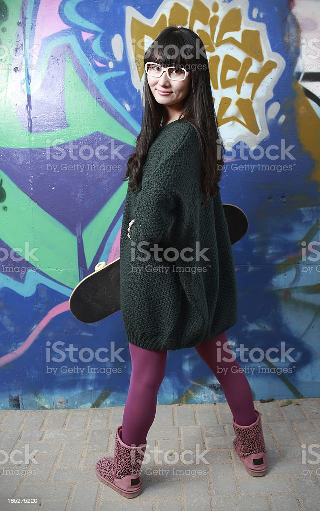 young Chinese girl Painting graffiti stock photo