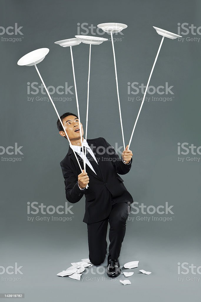 Young chinese man spinning dishes stock photo