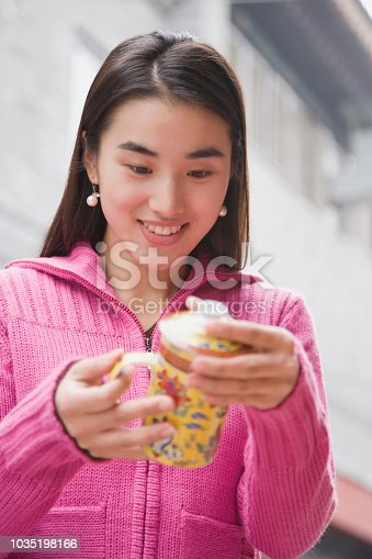 Young Chinese woman holding a mug