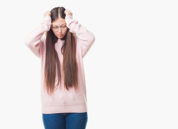 7912afbfc1d Young Chinese woman over isolated background wearing glasses suffering from  headache desperate and stressed because pain