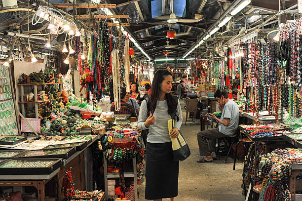 Young Chinese woman shopping at the jade market stock photo