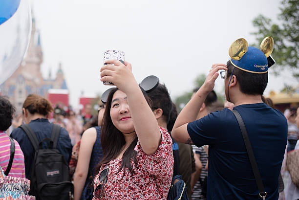 Young chinese woman taking a selfie in shanghai disneyland picture id538478186?b=1&k=6&m=538478186&s=612x612&w=0&h=ffpvavh9qw3u0wwfpxacl8sq3rvktlfgsyawmpkppx8=