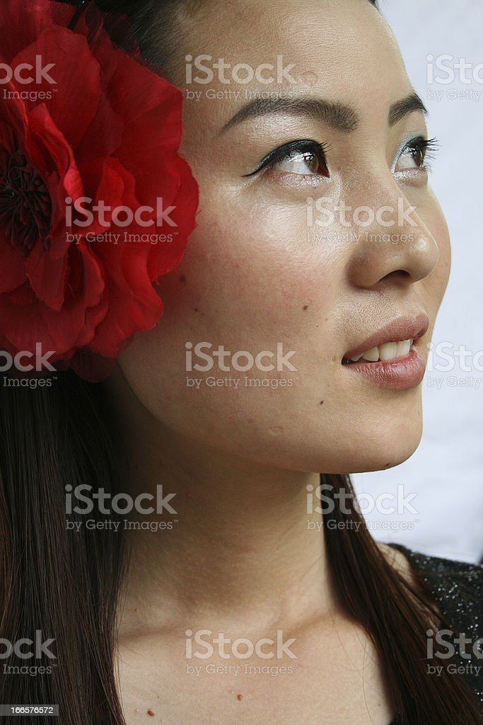 Young Chinese Woman With Flowers in Her Hair stock photo