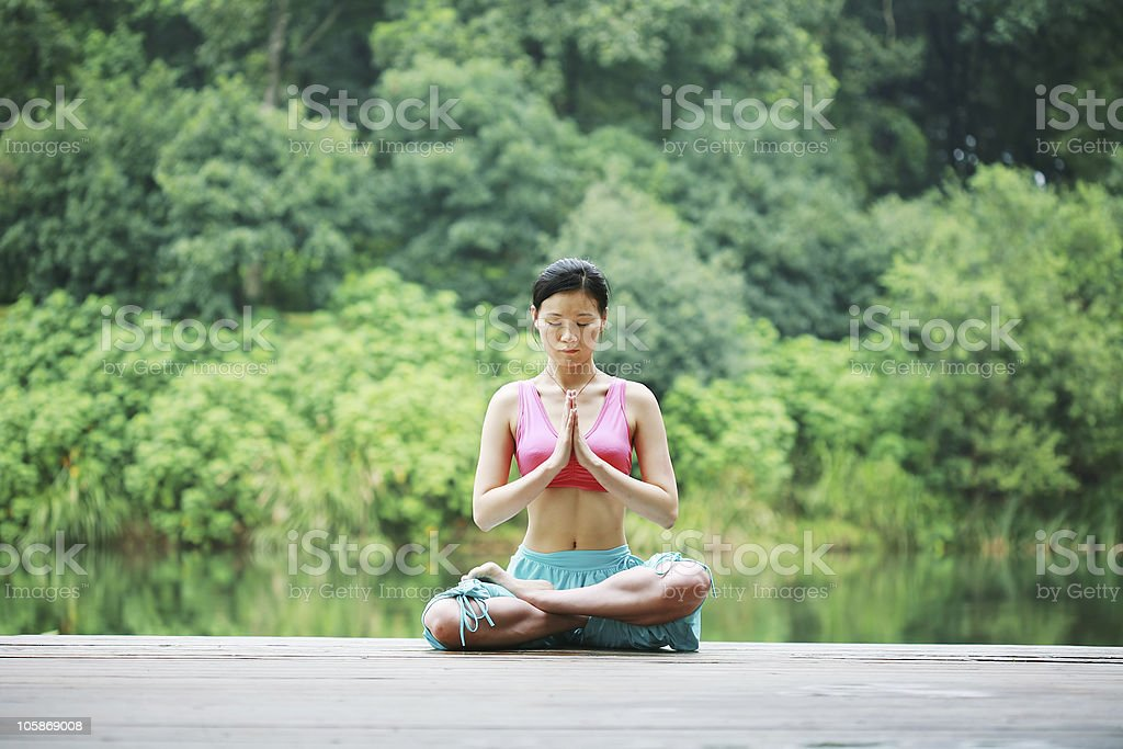 young chinese women doing Yoga style outside royalty-free stock photo