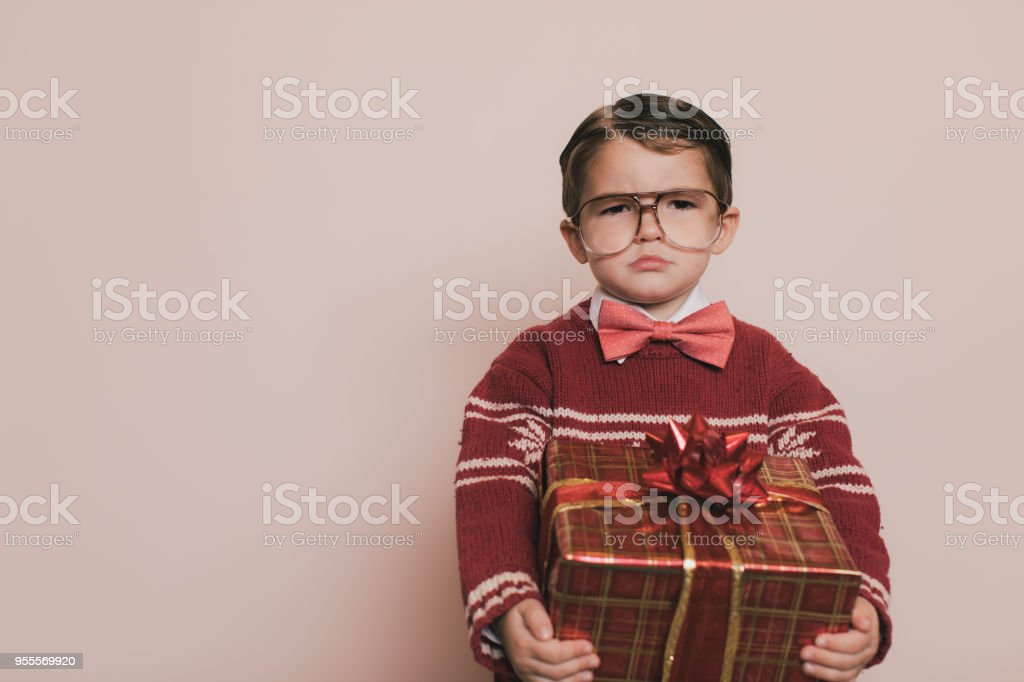 Young Christmas Sweater Boy with Gift stock photo