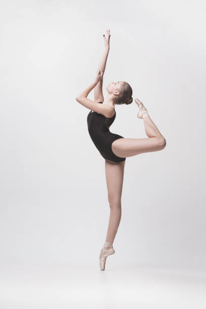 young classical dancer isolated on white background - ballet dancer stock photos and pictures