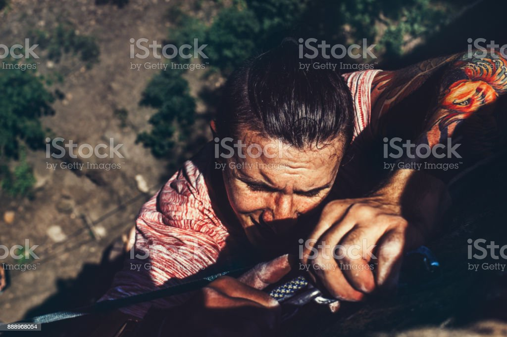 Young Climber Man On The Rock Wall, Close-up Of Male Hands With Tape In Magnesium Powder stock photo