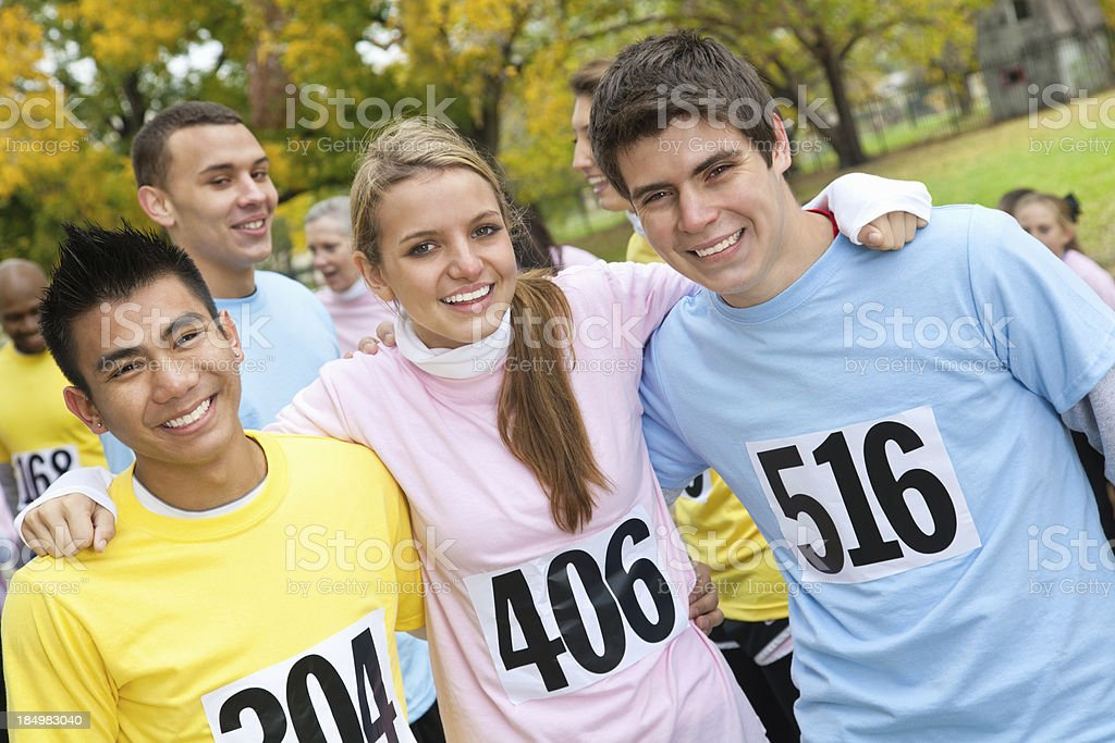 Young close friends smiling at a charity race royalty-free stock photo