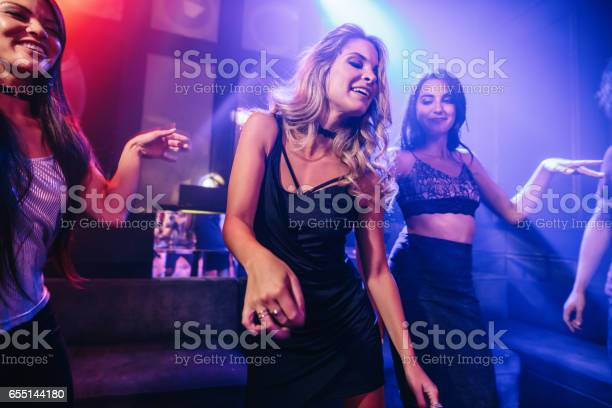 Young clubber dancing surrounded by her friends picture id655144180?b=1&k=6&m=655144180&s=612x612&h=5z l rqnhoudx6yu8wc 4i6fc bw87j9siv44clewew=