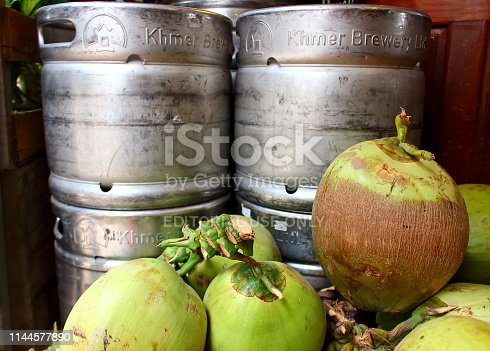 istock Young coconuts and metal beer keg 1144577890