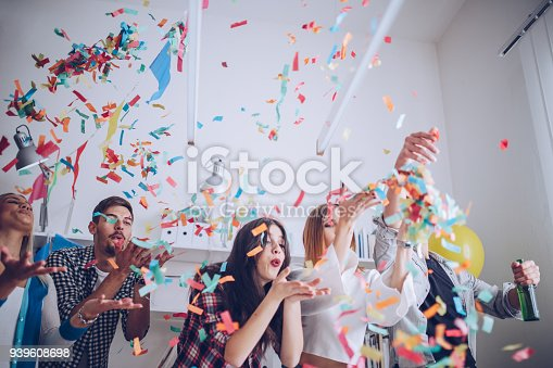 istock Young colleagues celebrating birthday 939608698