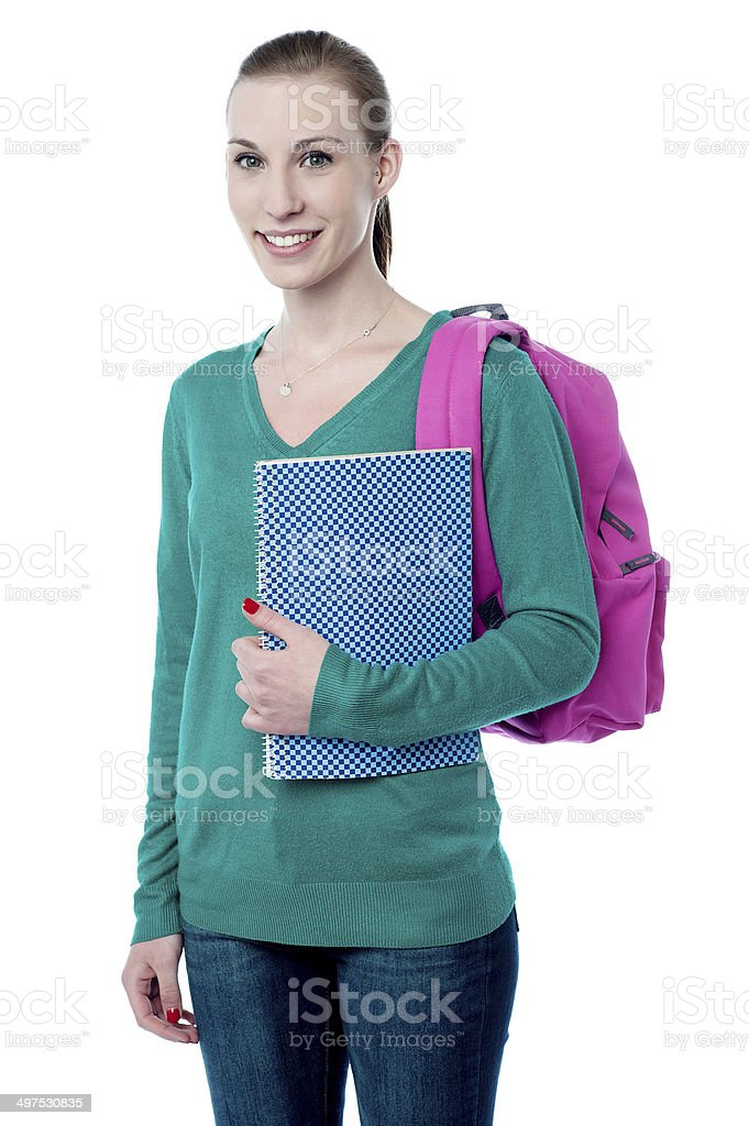 Young college girl with backpack and notebook royalty-free stock photo