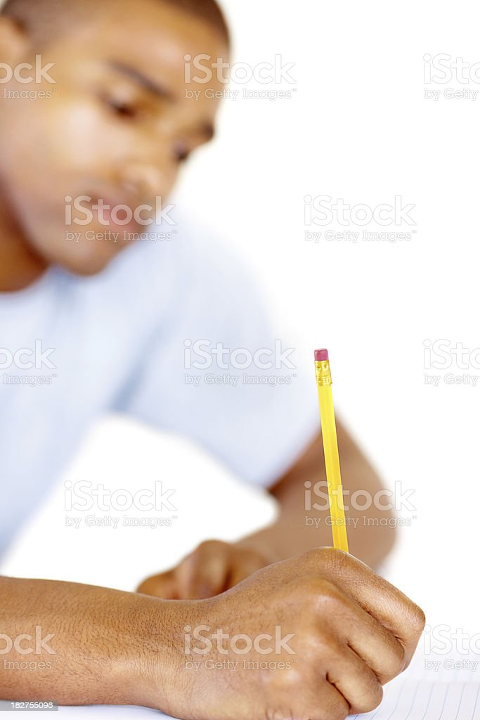 Young college guy writing down notes , focus on hand royalty-free stock photo