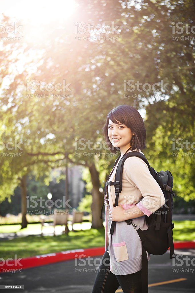 A young college student walking around outside royalty-free stock photo