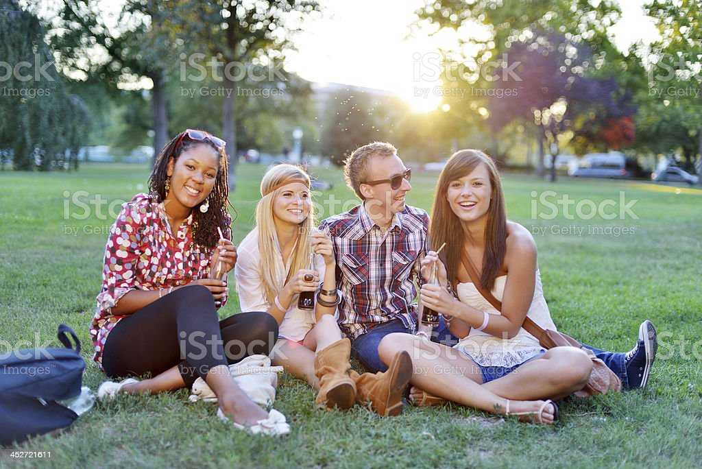 Young college students together in the park royalty-free stock photo