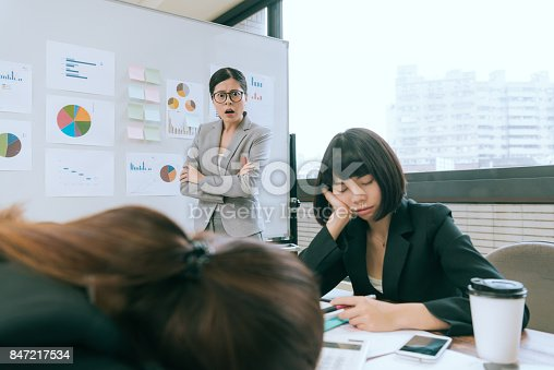 istock young company business woman looking at employees 847217534