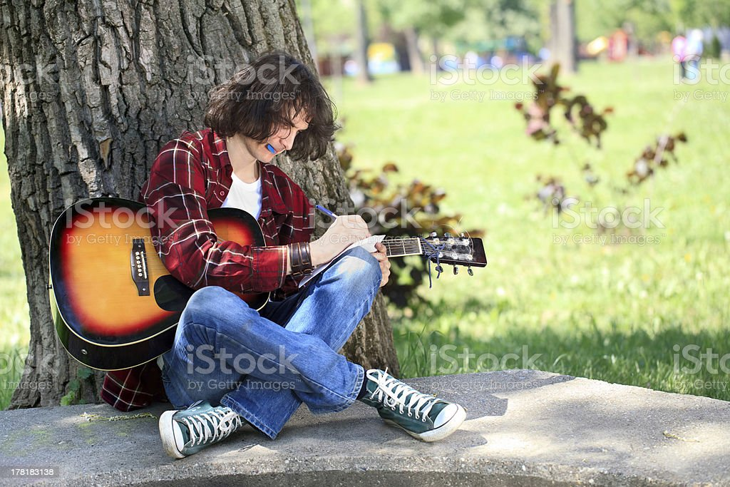 Young composer in park royalty-free stock photo