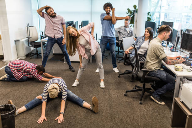 group of programmers exercising on a break in the office. - fare una pausa foto e immagini stock