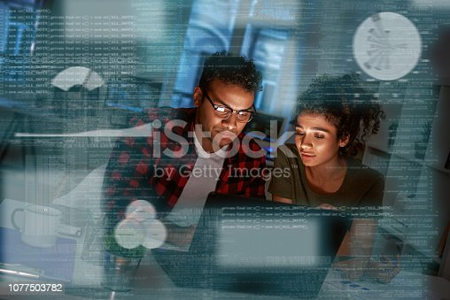 istock Young concentrated indian data analysts looking over the data 1077503782