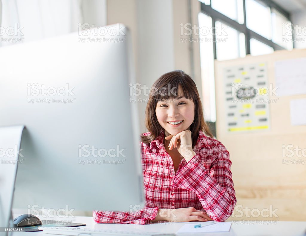 Young confident asian business woman stock photo