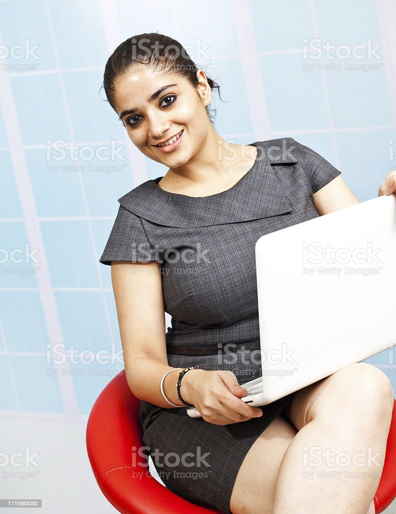 Young Confident Attractive Indian Businesswoman Using Laptop royalty-free stock photo