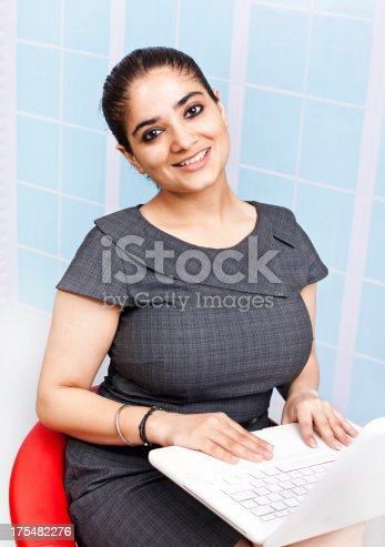 istock Young Confident Attractive Indian Businesswoman Using Laptop 175482276
