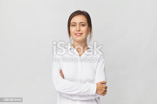 Amazing and cheerful smiling brunette in white shirt studio shot, isolated on white