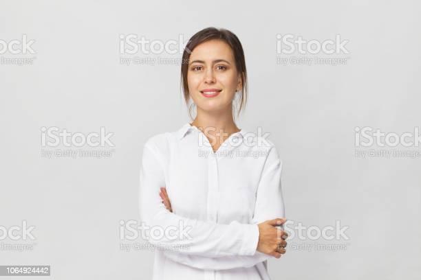 Young confident brunette woman in white elegant shirt smiling white picture id1064924442?b=1&k=6&m=1064924442&s=612x612&h=7taauumbtjhmyu2wvscwminainsasgxifc09jabaxba=