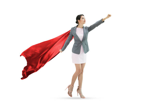 Young confident business superhero woman wearing red cape against isolated on white background. concept leader. stock photo