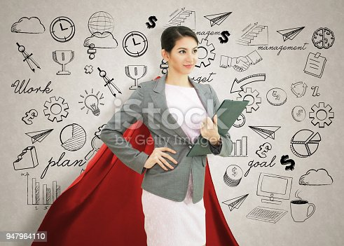 istock Young confident business superhero woman wearing red cape against with strategy background. concept point to future. 947964110