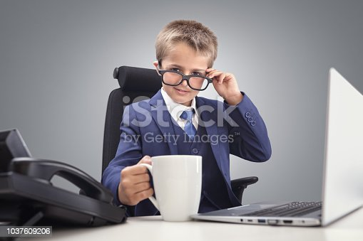 istock Young confident executive businessman boss boy in office 1037609206