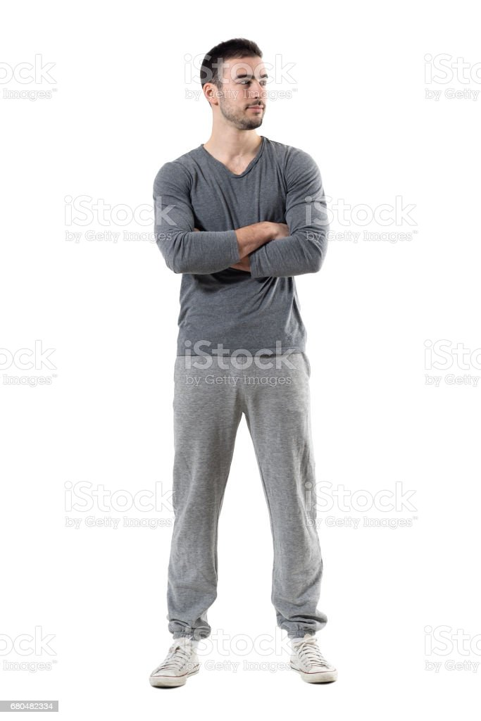 Young confident successful sporty athlete with crossed arms looking away and smile stock photo