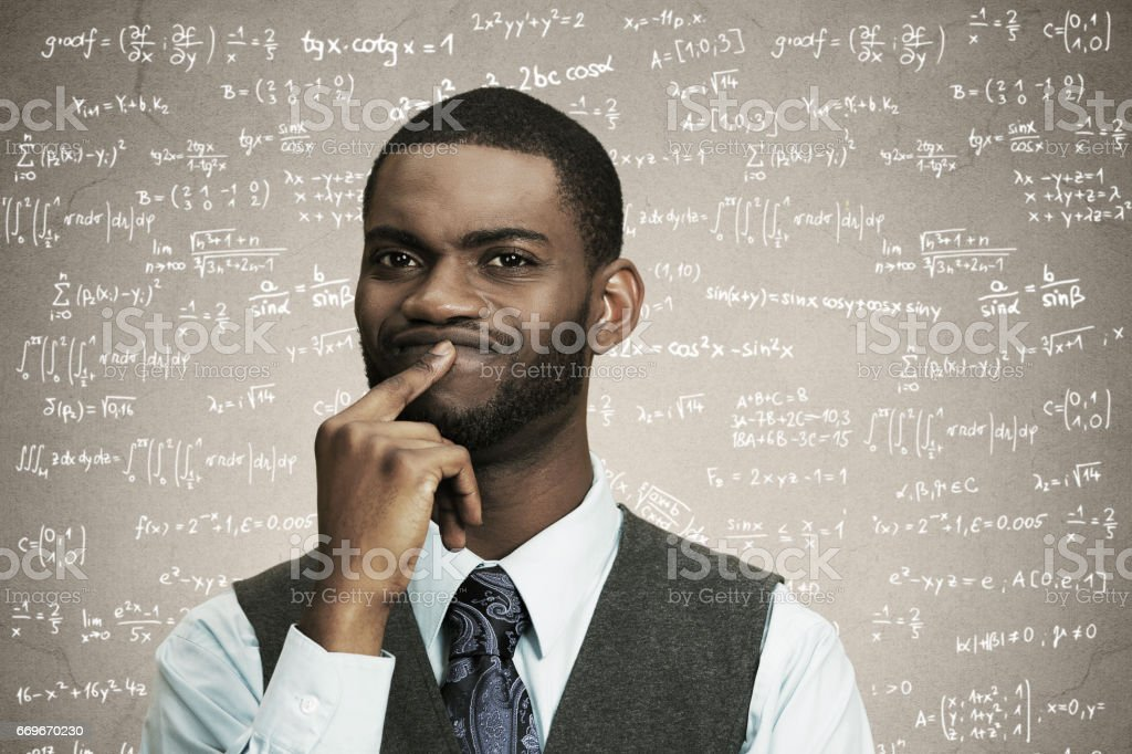 young confused business man finger on lips, thinking deeply about something stock photo