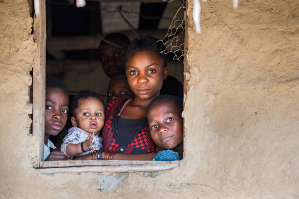 young congolese woman with her kids - democratic republic of the congo stock photos and pictures