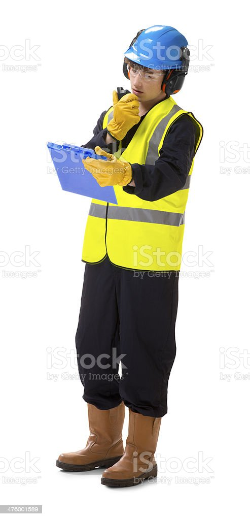 young construction worker checking docket royalty-free stock photo
