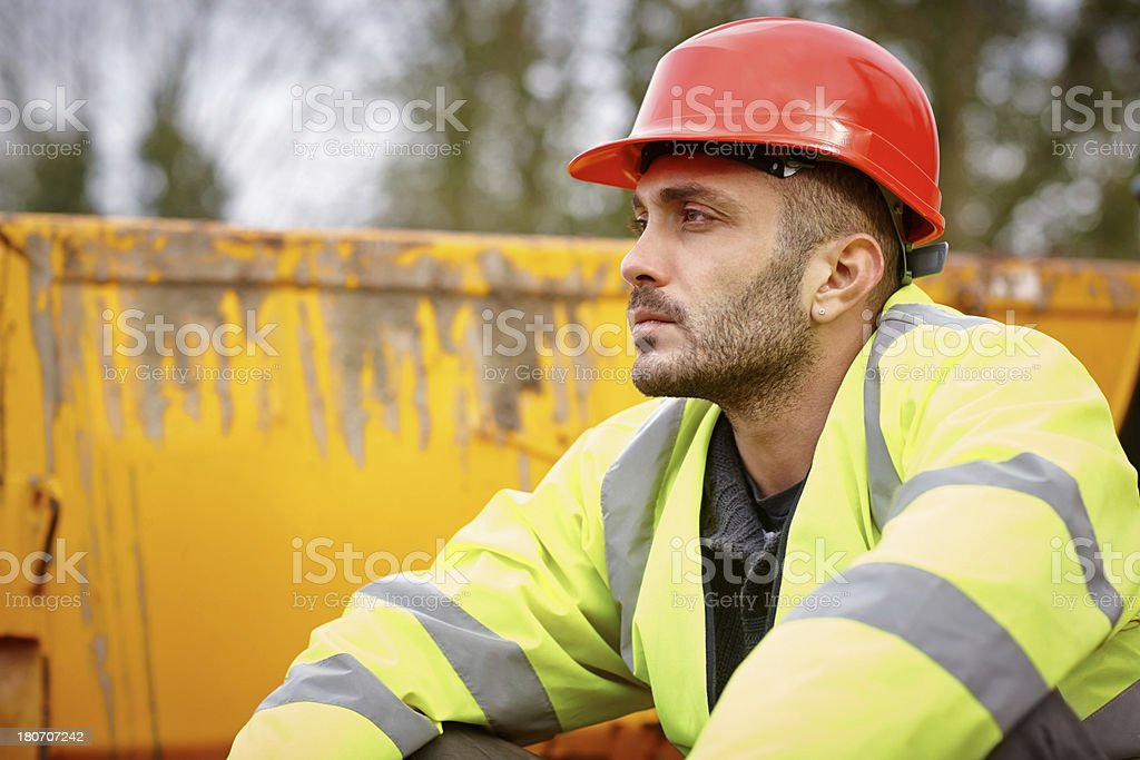 Young construction worker taking a rest break stock photo