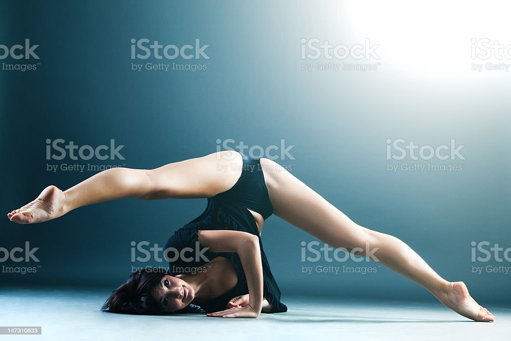 Young contemporary female dancer doing splits stock photo