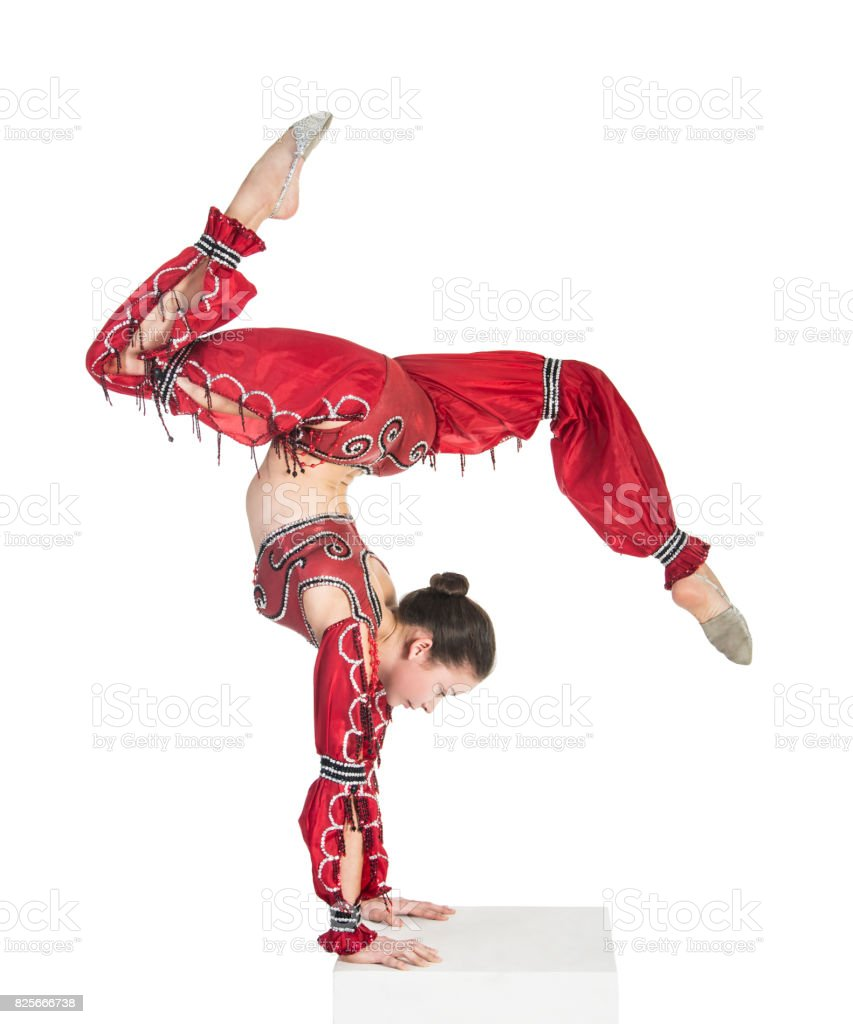 A young contortionist,circus performer in a red suit. stock photo