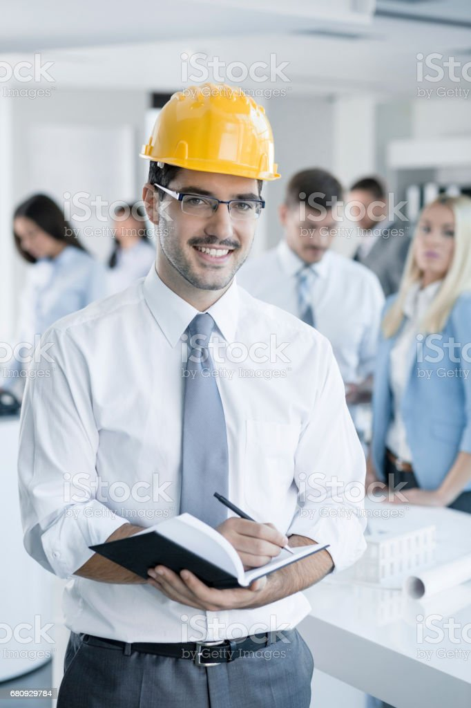 Young Contractor Taking Notes royalty-free stock photo
